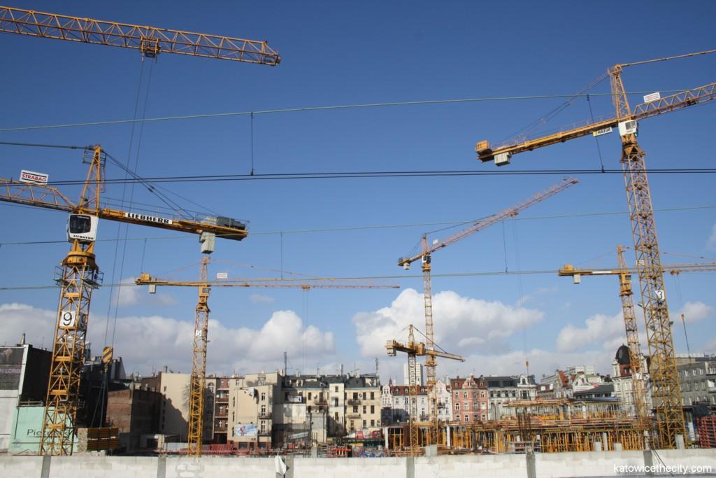 Seven of nine tower cranes operating at Szewczyka Sq. at present