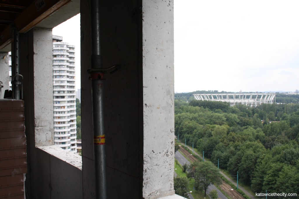 """The """"Kukurydze"""" residential buildings and the Silesian stadium in the background"""