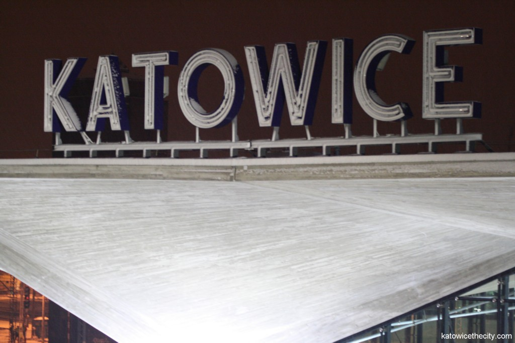 Katowice neon-sign on top of two cup-shaped pillars