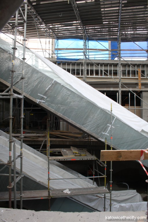 Construction work on new Silesia City Center, moving stairs on the ground level